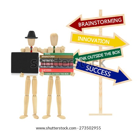 Stack of Books (Ideas, Brainstorm, Inspiration, Creativity, Innovation, Success, Think Outside the box) Laptop Directional arrows - stock photo