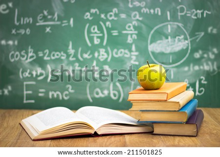Stack of books in classroom, concept - back to school - stock photo