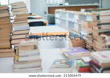 Stack of books in college library - stock photo
