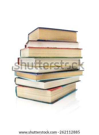 stack of books isolated on white background close-up. horizontal photo. - stock photo
