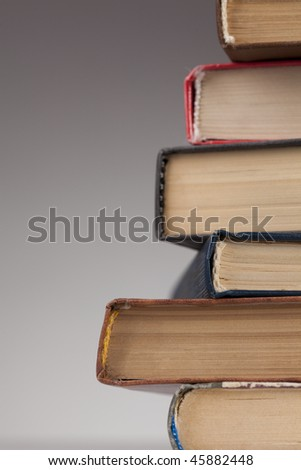 Stack of books isolated over gray background - stock photo