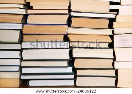 Stack of books on a bookshelf - stock photo