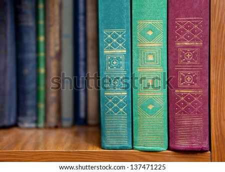 stack of books on a shelf - stock photo