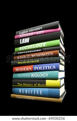 Stack of books on black - stock photo