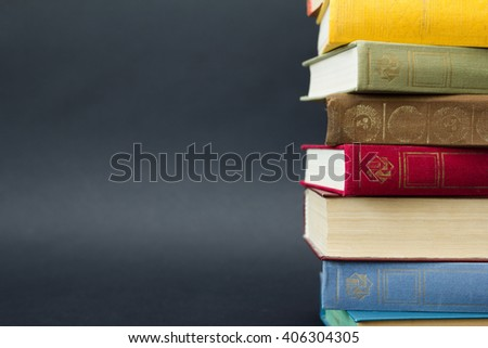 Stack of books on black background - stock photo