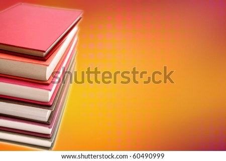 Stack of books on color background - stock photo