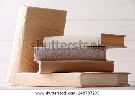 Stack of books on color wooden planks background