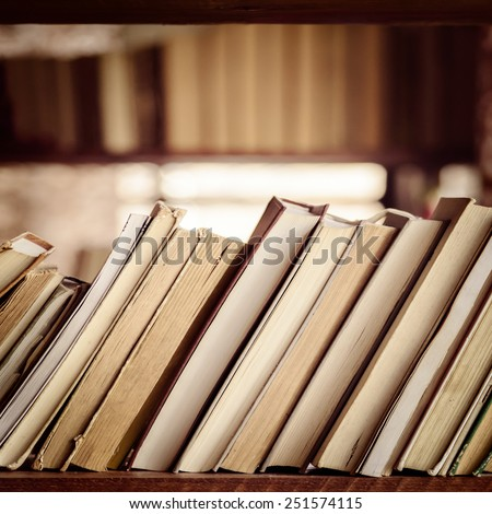 Stack of books on library bookshelf - Square composition - stock photo