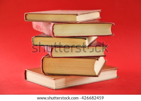 Stack of  books on red background - stock photo