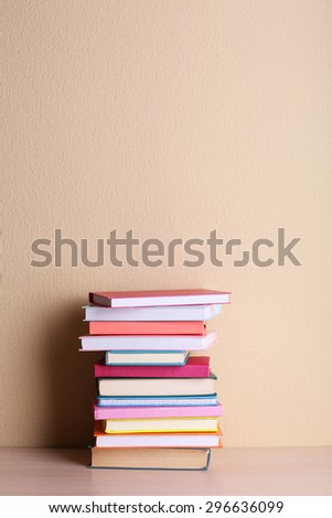 Stack of books on shelf. - stock photo