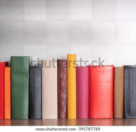 stack of books on the shelf, blank spines - stock photo