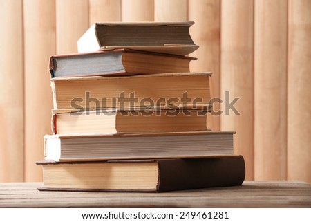 Stack of books on wooden planks background - stock photo