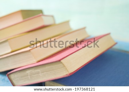 stack of books, selective focus, free copy space - stock photo