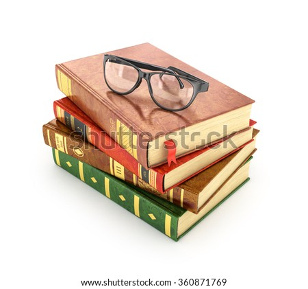 Stack of books with a pair of eyeglasses on top. - stock photo