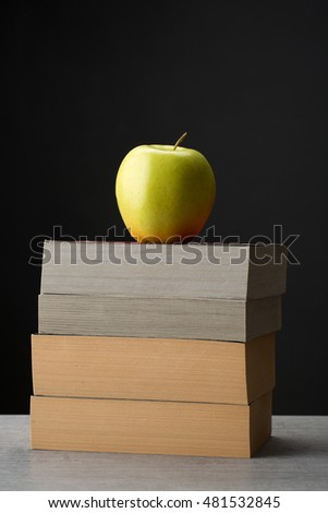 Stack of books with a red apple