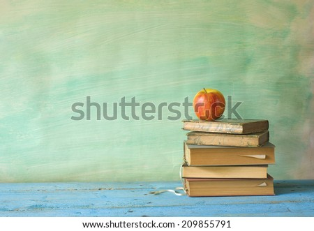 stack of books with apple, learning concept, free copy space - stock photo