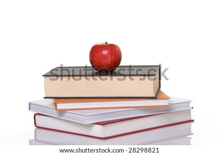 Stack of books with apple on top