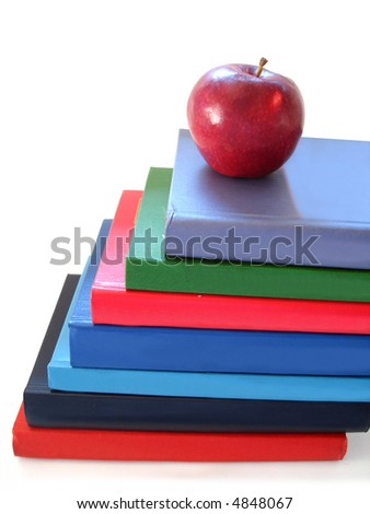 stack of books with apple over white background - stock photo