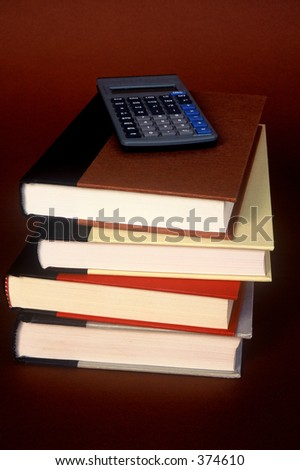 Stack of books with calculator