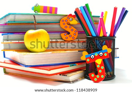 Stack of books with funny letters and a healthy snack - stock photo