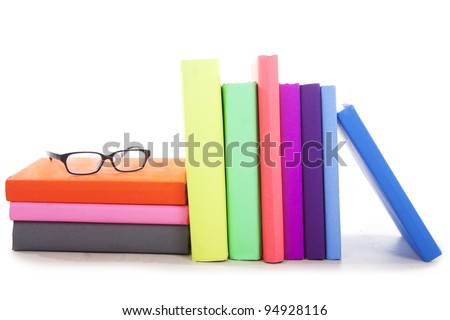 Stack of books with glasses - isolated - stock photo