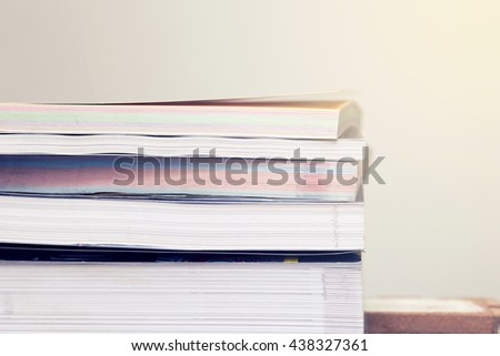 Stack of books with gradient colour filter effect,School Supplies concept. - stock photo
