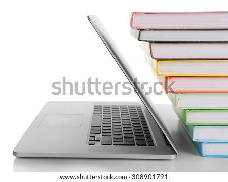 Stack of books with laptop isolated on white - stock photo