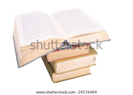 Stack of books with open one - stock photo
