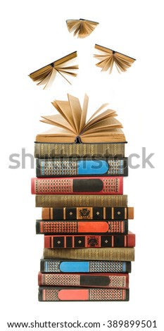 Stack of books with opened books flying away (education concept)