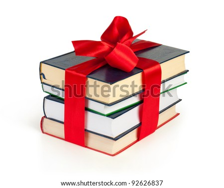 stack of books with ribbon like a gift isolated on white