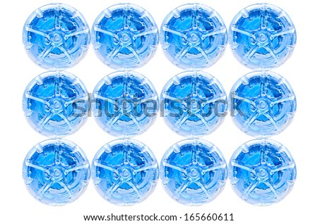Stack of bottom Of plastic bottles on white background - stock photo