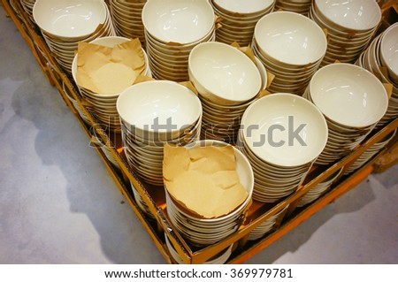Stack of bowls for sale in a store - stock photo