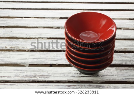 Stack of Bowls on Wooden Background