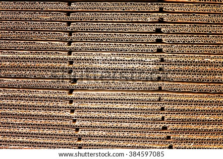 Stack of brown corrugated cardboard in a large pile - stock photo