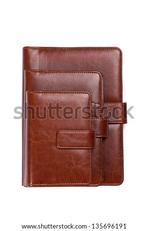 Stack of brown leather notebook on a white background