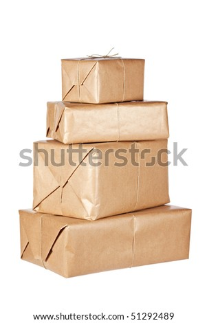 Stack of brown packages isolated on white background. Shallow depth of field - stock photo