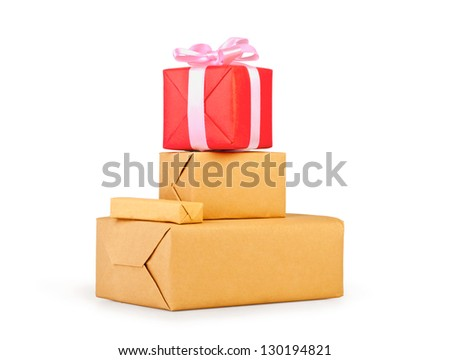 Stack of brown packages with gift box isolated on white background - stock photo