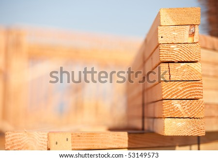 Stack of Building Lumber at Construction Site with Narrow Depth of Field. - stock photo