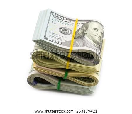 Stack of bundle dollar bills isolated on white background - stock photo