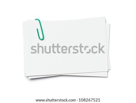 Stack of business cards with paper clip isolated on white background with clipping path - stock photo