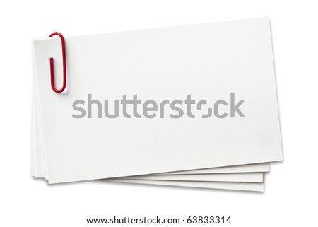 Stack of business cards with red paperclip.  Clipping path included. - stock photo