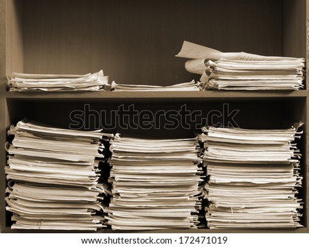 stack of business papers on the shelf  - stock photo