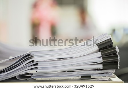 Stack of business pater with black clips - stock photo