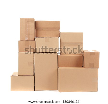 Stack of cardboard boxes. Isolated on a white background. - stock photo