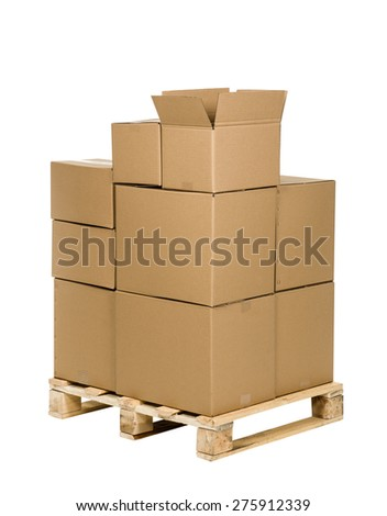 Stack of cardboard boxes on palette isolated on white background - stock photo