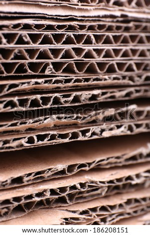 Stack of cardboard for recycling close-up - stock photo
