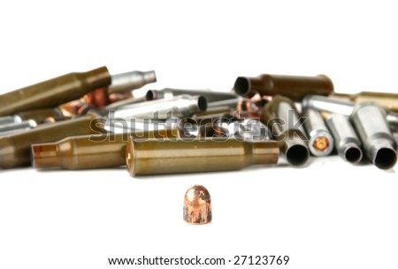 Stack of cartridge case and pistol bullet - stock photo