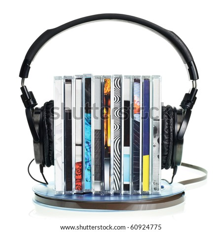Stack of CDs with HI-Fi headphones on vintage reel of audio tape on white background - stock photo