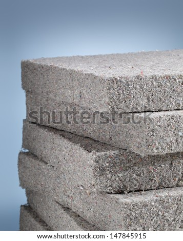 Stack of cellulose insulation batt panels, made of recycled newspapers, used as building thermal insulation. - stock photo