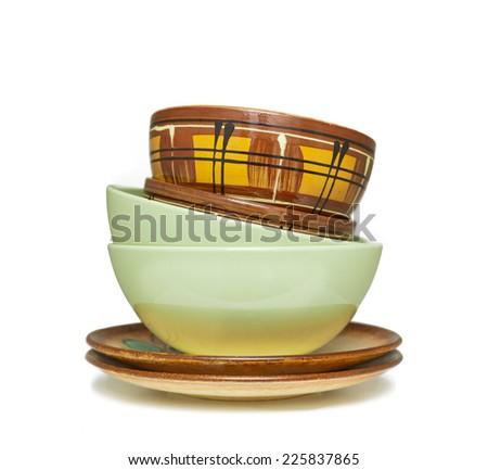 stack of ceramic plates isolated on white background - stock photo
